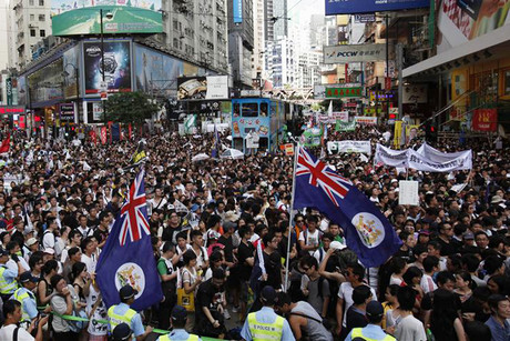 Thousands of protesters crowd a street urging new Hong Kong leader Leung Chun-ying to step down (Reuters)