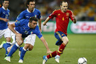 Spain's Andres Iniesta scoots away from the Italian defence (Reuters)