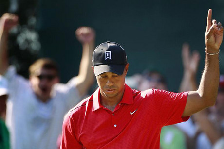 Tiger Woods points to the direction his golf is heading (Reuters)