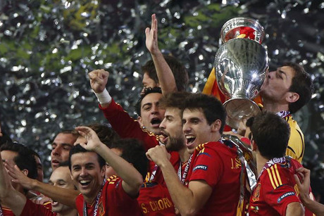 Spain defend their Euro 2012 title (Reuters)