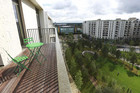 A balcony overlooks Victory Park in the Olympic Village built for the London 2012 Olympic Games in Stratford, east London (Reuters)