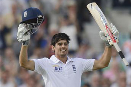 Alastair Cook raises his arms after making his ton (Reuters)
