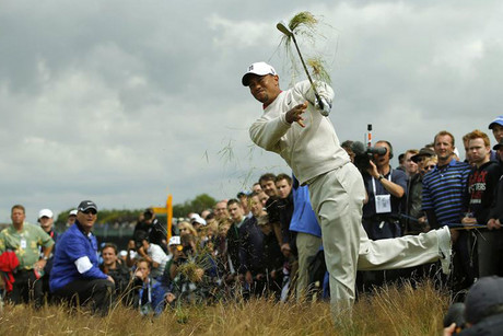 Tiger Woods digs his way out of the rough but the fans later thought it was rough not to acknowledge them with autographs (Reuters)