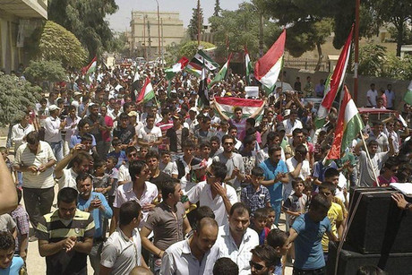 Demontrators protest near Aleppo on Friday  (Photo: Reuters)