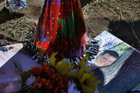 A photo of Alex Sullivan is seen at a memorial site for victims behind the theater where the shooting occurred in Aurora (Reuters)