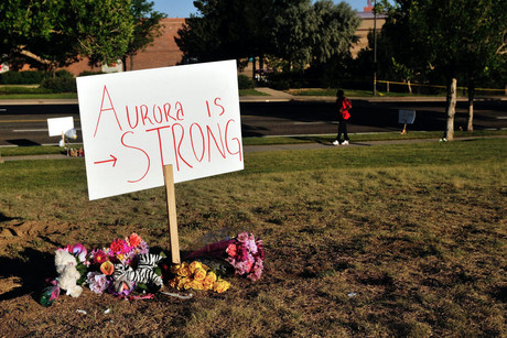 A memorial is set up near the Century 16 Theater in Aurora Colorado, USA, 21 July 2012 after a shooting spree by alleged gunman James Holmes (AAP)