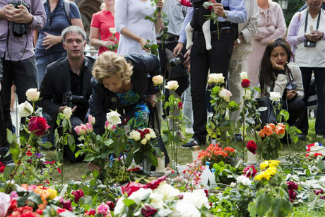 People lay down flowers outside the cathedral in Oslo (Reuters)
