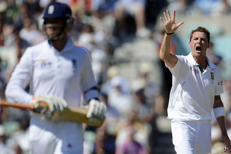 South Africa's Dale Steyn (R) celebrates and gestures after dismissing England's Graeme Swann (L) for Steyn's fifth wicket during the first cricket test match at the Oval cricket ground in London (Reuters/Philip Brown)