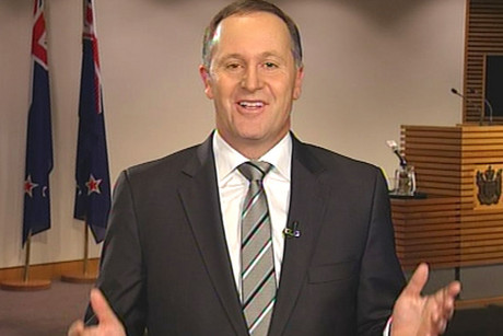 John Key says being smoke-free is in New Zealand's interest, but he hasn't made up his mind on whether plain packing for cigarettes should be introduced