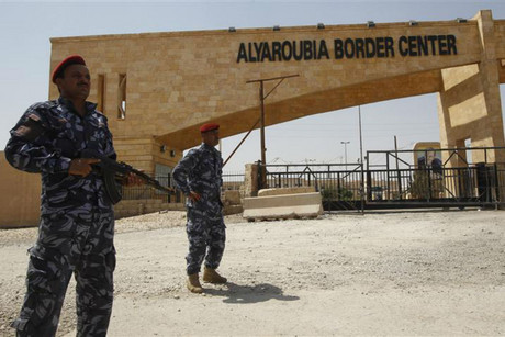 Iraqi Police stand guard at the Rabia border crossing (Reuters)