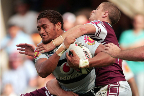 Warriors wing Manu Vatuvei is tackled by Travis Burns (Photosport)
