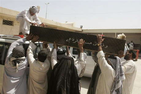 Relatives of a victim killed in one of Monday's bomb attacks, carry a coffin (Reuters)