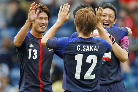 Japan's players including Daisuke Suzuki and Gotoku Sakai celebrate (Reuters)