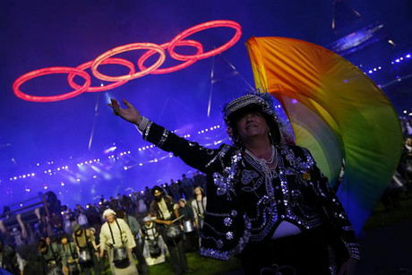 A performer gestures as the Olympic rings are seen above, during the opening ceremony of the London 2012 Olympic Games at the Olympic Stadium (Reuters)