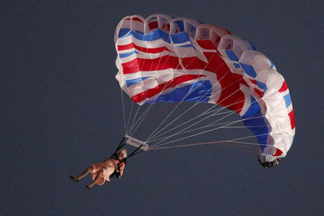 'Queen Elizabeth II' leaps from a helicopter over the stadium (Reuters)