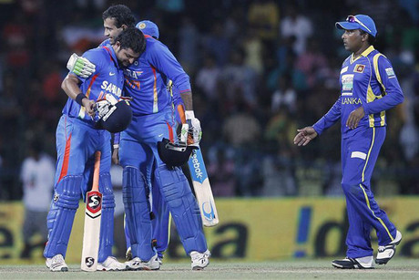 Irfan Pathan and Suresh Raina celebrate after winning