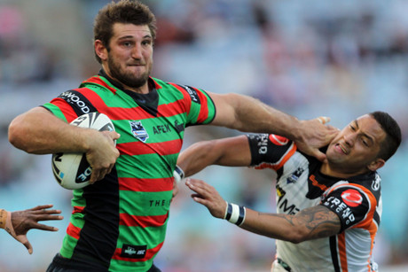 Souths Dave Taylor fends off Benji Marshall (NZN)