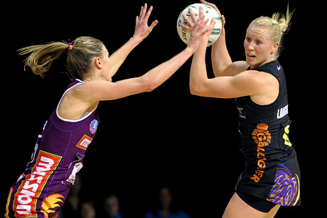 Magic's Laura Langman, with ball, competes against Firebirds' Amy Steel (Photosport)