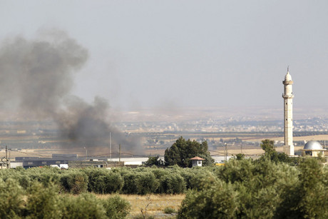 Smoke rises from Azaz vilage north of Aleppo, Syria (Reuters)