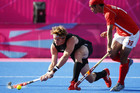 New Zealand's Andrew Hayward and South Korea's Kim Young Jin fight for the ball