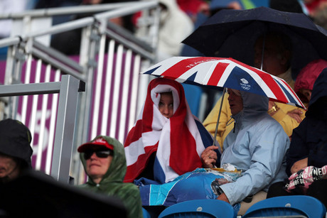 Spectators brave the rain during the Dressage phase of the Eventing at Greenwich Park (AAP)