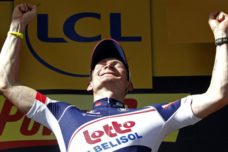 Andre Greipel of Germany celebrates on the podium after winning the fourth stage (Reuters)