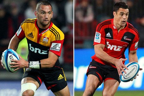 Chiefs' Aaron Cruden, left, up against Crusaders' Dan Carter
