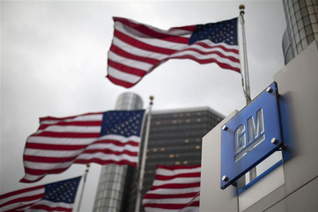dFlags wave behin a General Motors Corp sign in downtown in Detroit (Reuters)