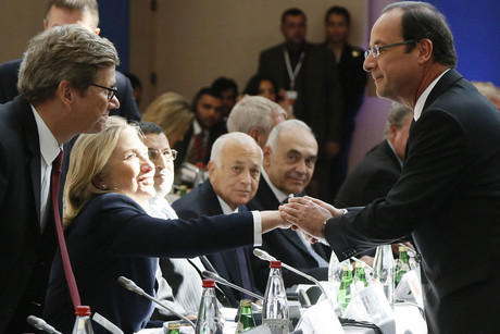 "French President Francois Hollande (R) shakes hands with U.S. Secretary of State Hillary Clinton as German Foreign Minister Guido Westerwelle looks on during the third meeting of the ""Friends of Syria"" group in Paris (Reuters)"
