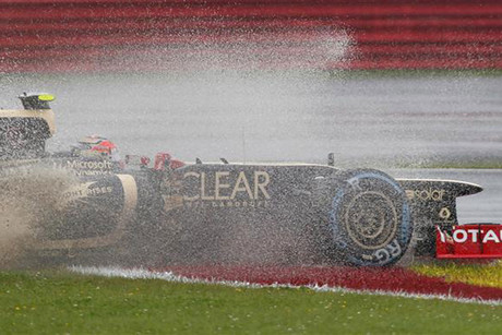 Romain Grosjean takes a little wet detour (Reuters)