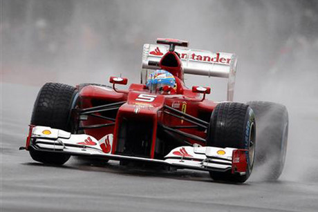 Formula One leader Fernando Alonso put Ferrari on pole (Reuters)