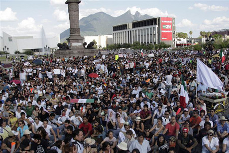 Anti-PRI protesters from Yosoy132 sit at the Macroplaza after taking part in a march in Monterrey (Reuters)