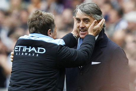 Roberto Mancini withcoaching staff member (Reuters file)