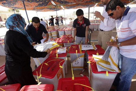 Libya High National Election Commission workers check ballot boxes (Reuters)