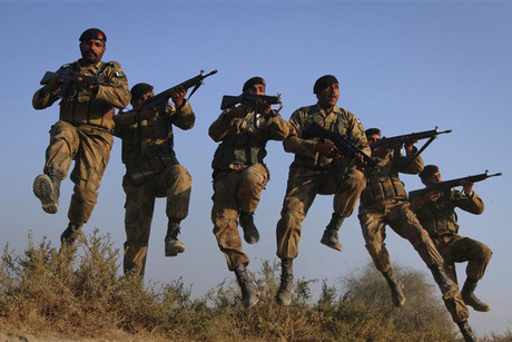 Pakistan Army soldiers take part in winter military exercises in the Cholistan desert, near the Pakistan-India border (Reuters)