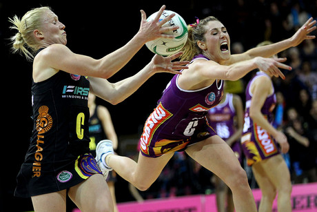 Magic's Laura Langman gets the ball ahead of Firebirds' Elissa Macleod (Photosport)