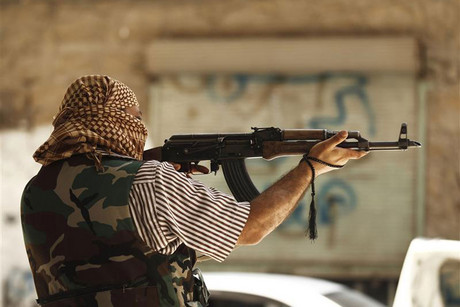 A member of the Free Syrian Army aims his weapon in Aleppo (Reuters)