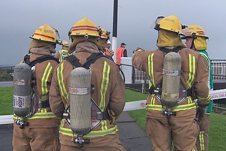 Firemen at the scene in Manurewa