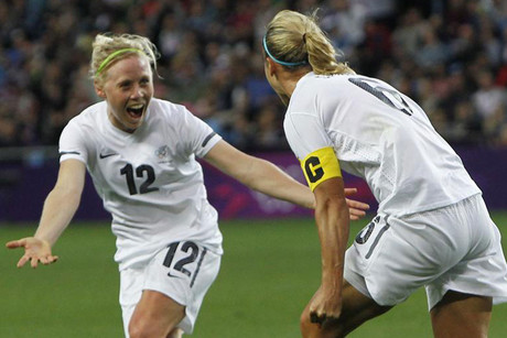 New Zealand's Rebecca Smith, right, celebrates scoring a goal against Cameroon with team mate Betsy Hasset  (Reuters)