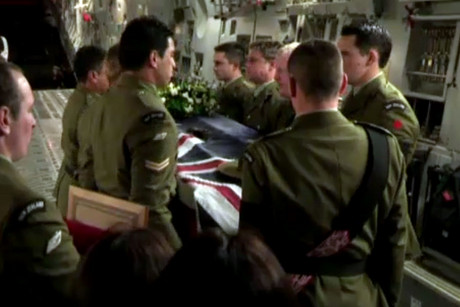 Soldiers carry their comrades' bodies out of the plane