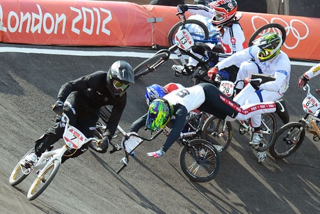 New Zealand BMX rider Marc Willers manages to avoid the carnage behind him during the quarter finals at the BMX Track (Photosport)
