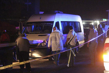 Forensic technicians stand around white van containing dead bodies (Reuters)