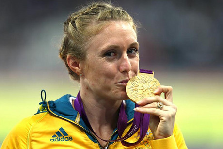 Australia's Sally Pearson kisses her gold medal after winning the women's 100M hurdles  (Reuters)