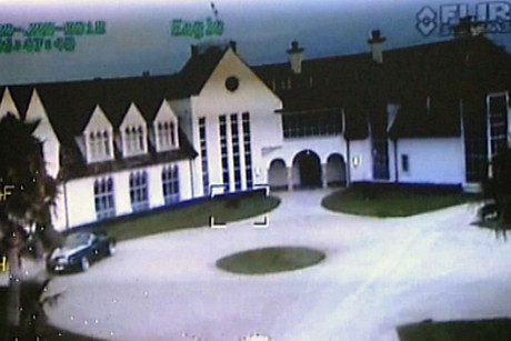 Police footage of Dotcom's mansion on the day of the raid