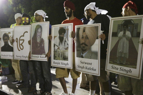 Sombre, tearful mourners, most wearing scarves on their heads in the Sikh tradition, greeted victims' family members with hugs at the Oak Creek High School gymnasium.