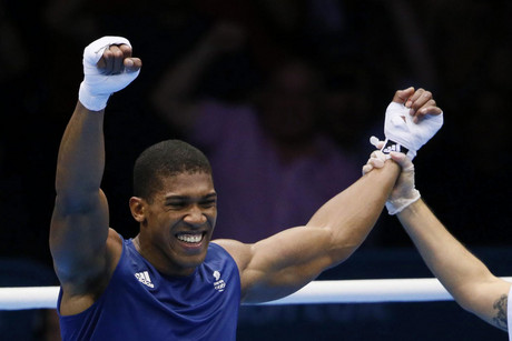 Anthony Joshua of Great Britain celebrates after defeating Ivan Dychko of Kazakhstan in the Men's Super Heavy (+91kg) Semifinal at the London 2012 Olympic Games (Photo: AAP)
