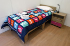 A bed is seen inside a flat at the London 2012 Olympic Games Athletes Village in Stratford, east London (Reuters/Suzanne Plunkett)