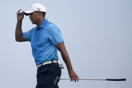 Tiger Woods of the U.S. reacts as he walks off the 13th green during the second round of the PGA Championship golf tournament at The Ocean Course on Kiawah Island, South Carolina (Reuters/Matthieu Belanger)