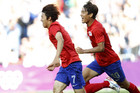 South Korea's Park Chu-young (R) congratulates his team mate Kim Bo-kyung after he scored the second goal against Switzerland during their men's Group B football match in the London 2012 Olympic Games (Reuters/Alessandro Garofalo)