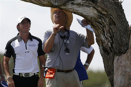 McIlroy and a marshal during the third round of the PGA Championship golf tournament at The Ocean Course on Kiawah Island (Reuters)